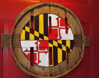 Maryland flag in center circle.  Unique, hand painted on recycled crab bushel lid. Weather resistant & ready to hang!