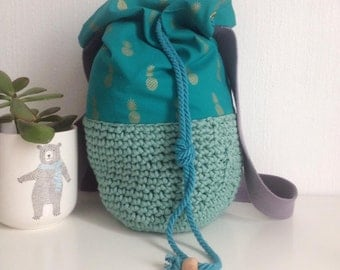 Crocheted pineapple fabric and cotton backpack bag