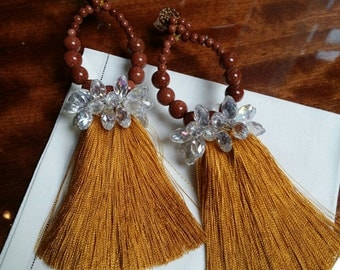 Gold silk earrings and perls in different colors