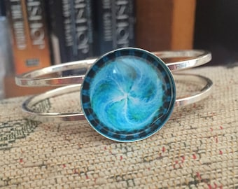 Psychedelic blue swirly silver bangle