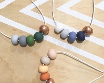 Polymer clay bead necklace. Copper glitter, blue, green, rust. 'The erin'