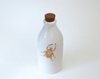 Upcycled Vintage Milk bottle decorated with 22 Karat Gold Beetles
