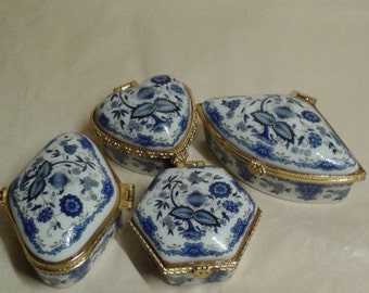 Set of four Chinese trinket boxes