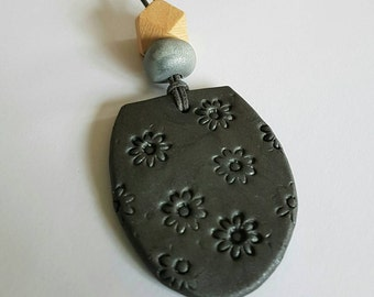Charcoal clay pendant necklace.