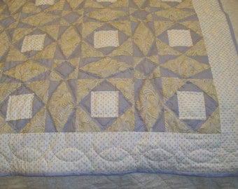 Muted gray and yellow Storm at Sea crib quilt; stars