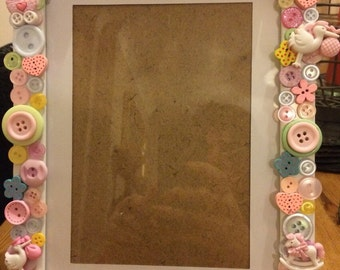 Unique personalised button photo frame.