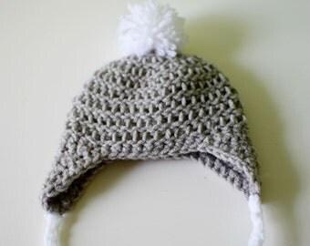 Crochet newborn earflap hat with pompom
