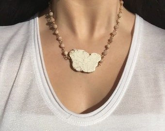 Natural beige rosary chain necklace with a creme rock slab