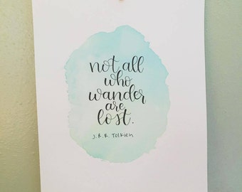 """Hand lettered on an original water color background """"Not all who wander are lost"""" quote by J.R.R. Tolkien"""