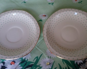 Pair of hexagonal green spotted china saucers.