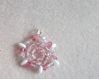 Pink pendant with pink and green bicone and white rizo beads