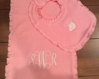 Matching bib and burp pad set. Pink ruffle.