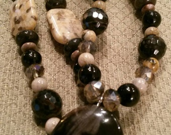 Necklace: Petrified Wood, Agate, Feldspar, Sandstone, and Crystal