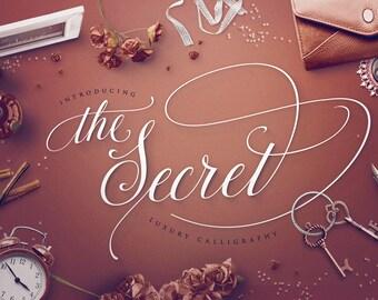 Script font - The Secret luxury calligraphy typeface script with more then 50 super elegant swashes.