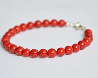 Red coral bracelet with drop shaped charm, 18,5cm-19cm
