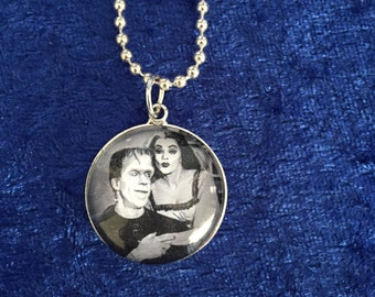 Lily and Herman Munster pendant