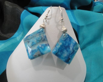 Highly polished blue agate gemstone sterling silver earrings.