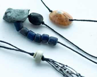 stone and bone talisman necklace-  assymetrical found rock, shell and bone with Indonesian glass and linen tribal assemblage pendant