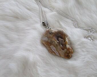 Pretty agate geod slice necklace.