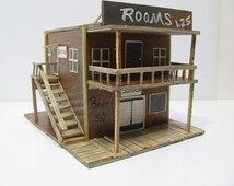 Old Western Saloon, boarding house, doctor's office and barber shop. All in one. Miniture storage box