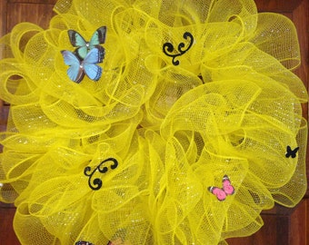 Yellow mesh wreath with butterflies