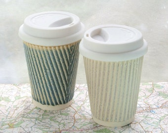 Coffee cup or ceramic travel mug with lid. White porcelain cups. Ceramic travel cups for use as a tea cup, coffee cup or succulent planter.