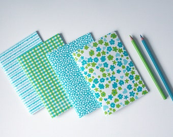 Set of 4 small colored notebooks (pink or blue)