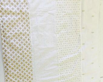 Gold and cream quilt