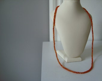necklaces orange carneol pearls 5mm ca 73 cm long with silver lcok and silver platet eye