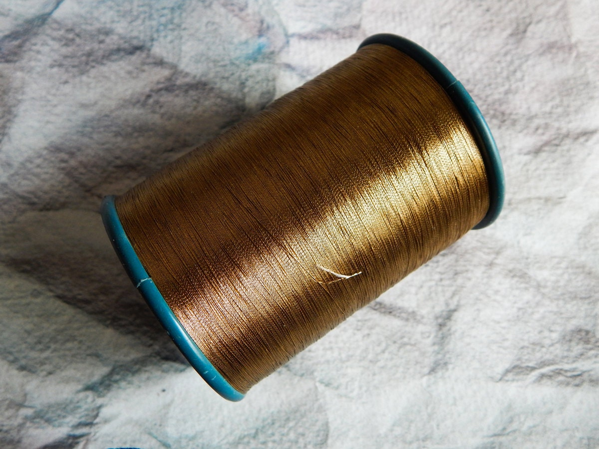 Gold metallic thread embroidery hand and machine