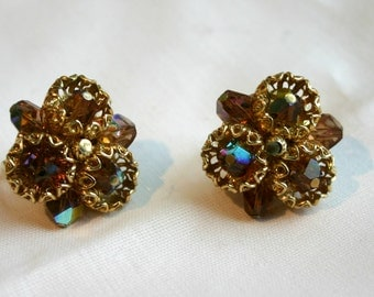 Vintage clip on earrings.  Gold tone with beautiful jewel beads.