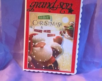 grandson Christmas card with a Santa Claus theme, this card is suitable for all younger grandsons and has a festive cheery look at Christmas