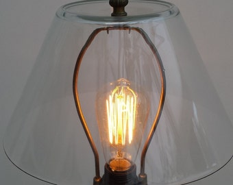 Black wood stand with glass lampshade, stylish, mid height lamp including new  Edison style light bulb.