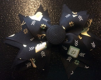 Black and gold spiked bow
