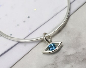 Handmade Sterling Silver and Blue Topaz Lucky Evil Eye Charm Bangle By LuLu & Charles Jewellery