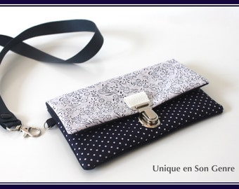 Pocket multi-purpose removable neck. Navy Blue with white polka dots