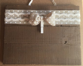 Soft brown polka dot accents picture frame/holder.