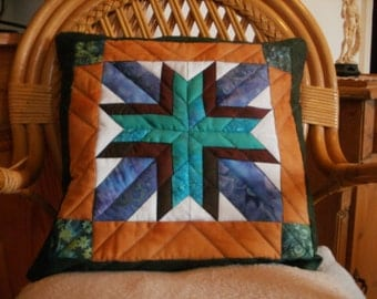 Patchwork cushion in blues and browns