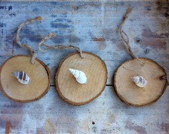 Wooden discs with shell decoration.