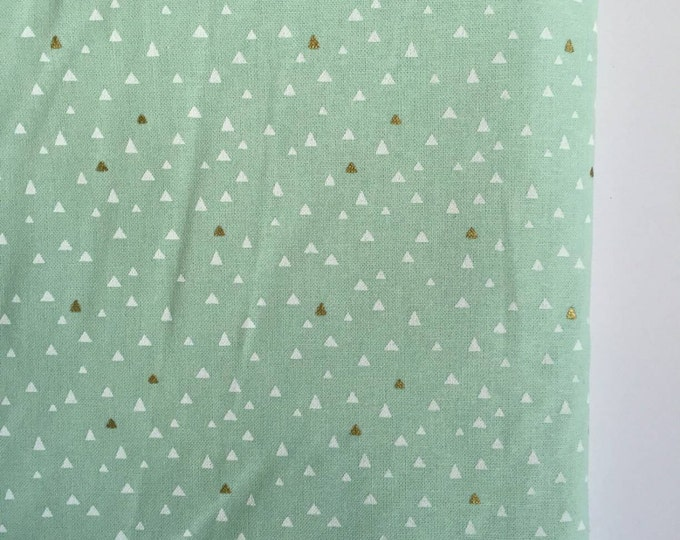 Mint sheet featuring white and gold triangles