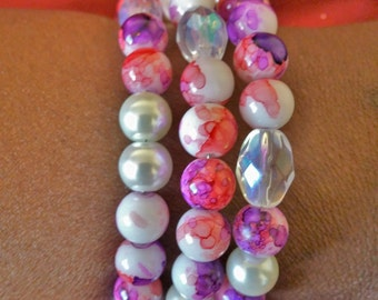 Memory wire bracelet with white pearl annd purle,white,red beads and more.