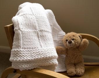 Easy baby blanket knitting pattern.  Traditional basket weave blanket. Beginner knitting. Swaddling cloth. Straight or circular needles.