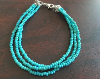 Turquoise seed bead bracelet with three strands