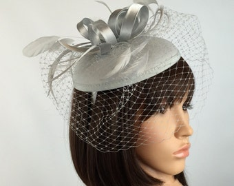 Silver fascinator Grey Felt Fascinator Wedding Hatinator Pill box Hat and net veil. Races, Weddings, Bride, Occasion, Parties,