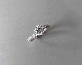 MQ217 -Diamond set solitaire ring