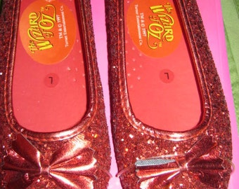 the wizard of oz child's ruby slippers.