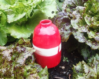Small candy red bottle
