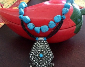 Real turquoise necklace with bali silver pendant