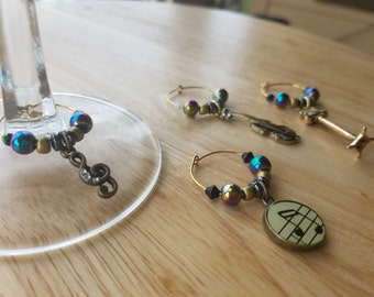 Set of 4 music-themed wine charms