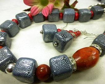 Grey porcelain jewelry set with coral